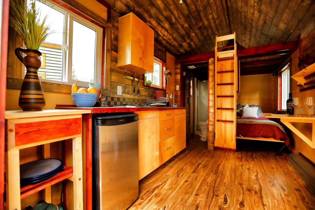 our standard micro homes on wheels are 86 wide up to 136 tall from ground to roof in length from 14 to 34 long and include the following - Micro Home
